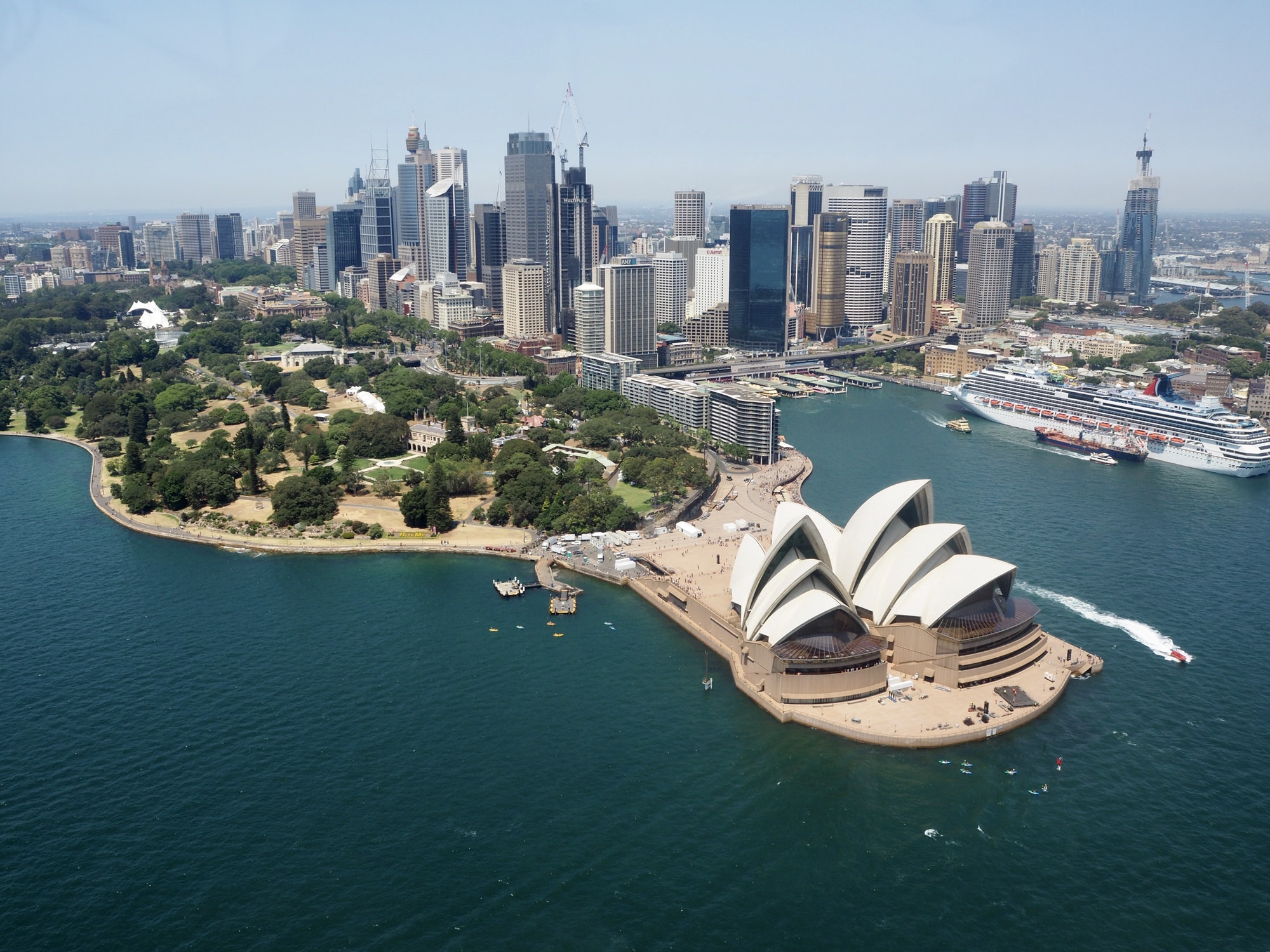 View of Sydney Opera house from the air and city skyline