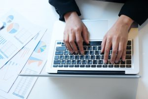 Business working in office concept. Typing hands.